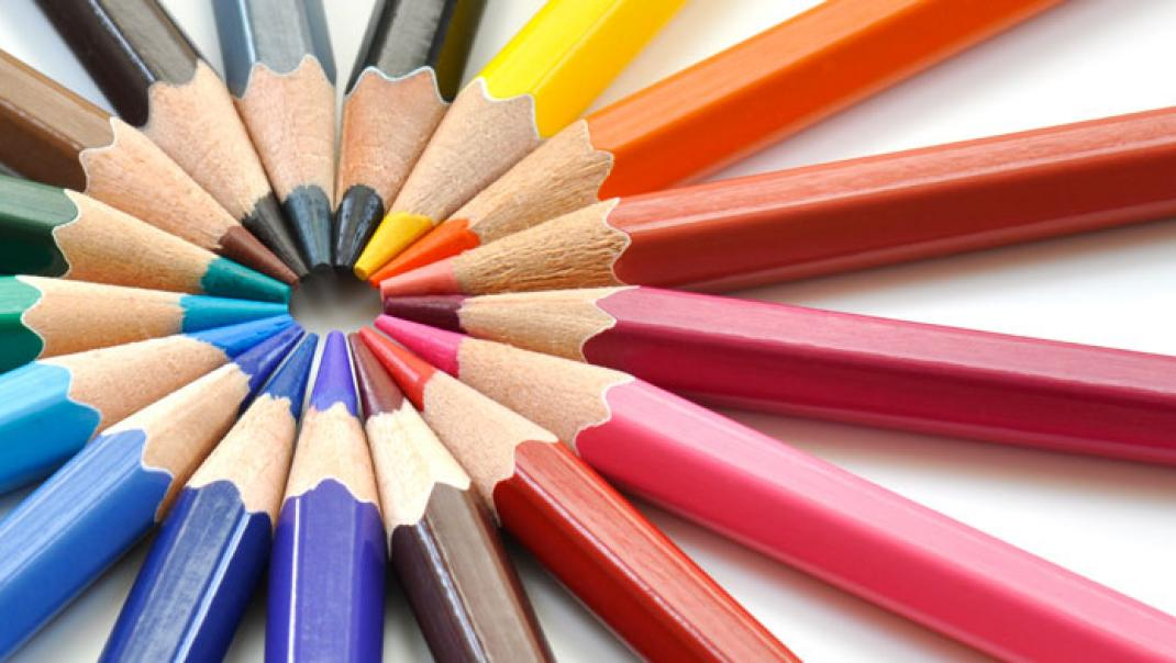 Coloured pencils pointing in at each other.