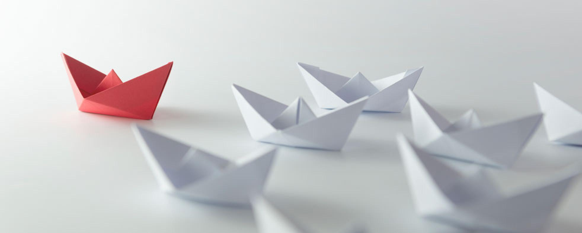 An origami boat leading the way.