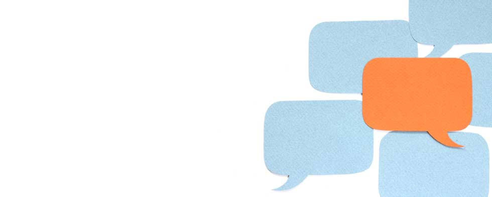 Paper cut-outs of word bubbles.