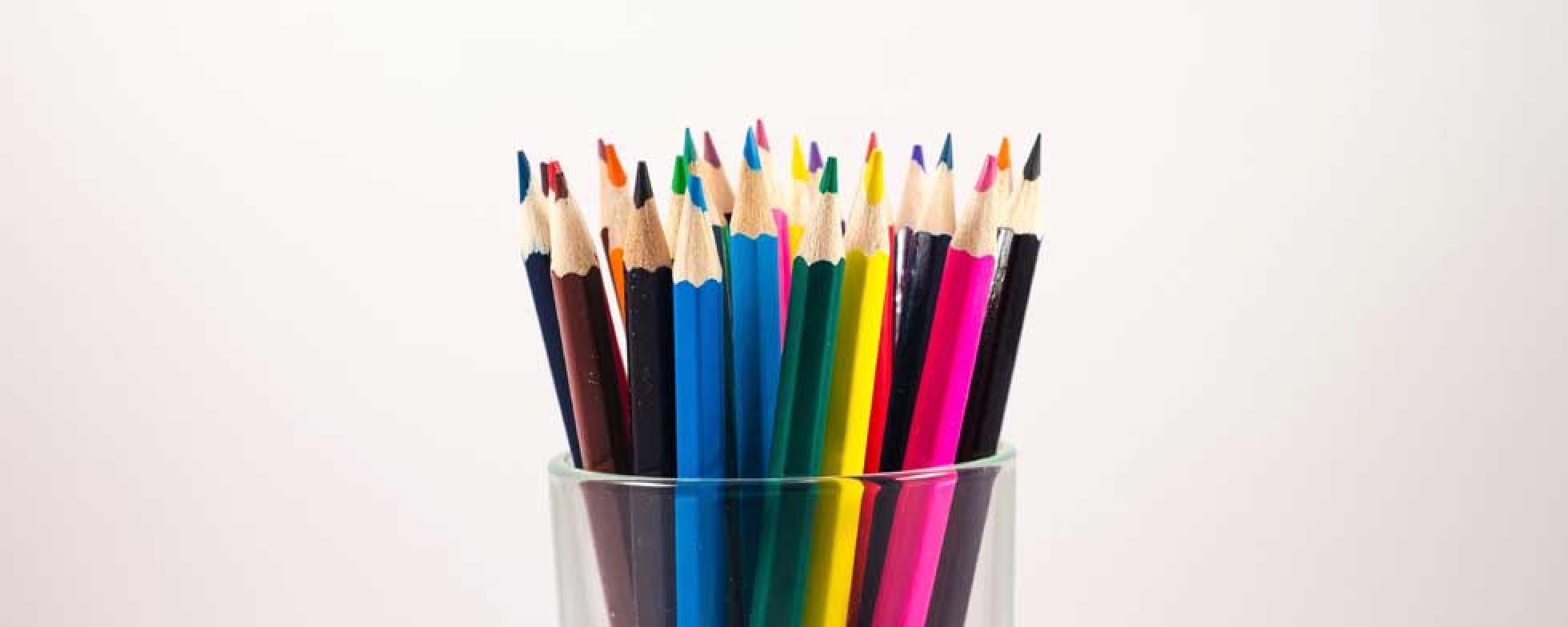 Coloured pencils in a glass.